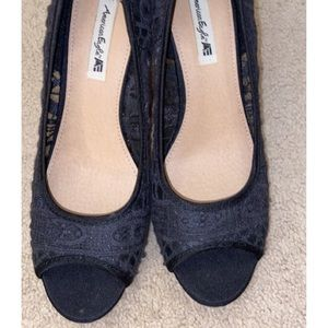 Black wedges with lace pattern on top